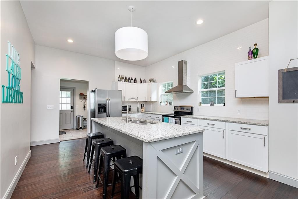 Kitchen area, Granite Counters, SS appliances, the center island is large!  Lot's of cabinet & counter space!