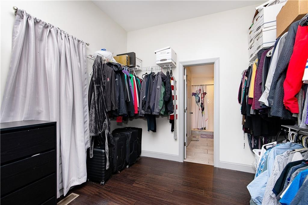 This room is the walk through closet, it could be an additional reading room, storage space, secondary office space.